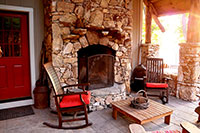 Cabin with outdoor stone fireplace